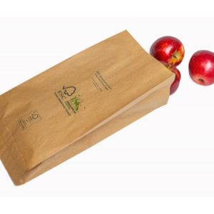 Paper produce bag with apples falling out of paper bag